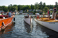 Beverly Dieterich pulls her 1910 Johnson Laker in beside Howard Newton's 1925 F.W. Johnson during the Alton Bay Antique Boat Show on Saturday morning.  (Karen Bobotas/for the Laconia Daily Sun)