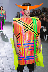 © Licensed to London News Pictures. 28/05/2013. London, England. Collection by Xue Li. Central St Martins BA Fashion show with collections by graduate fashion students. Photo credit: Bettina Strenske/LNP