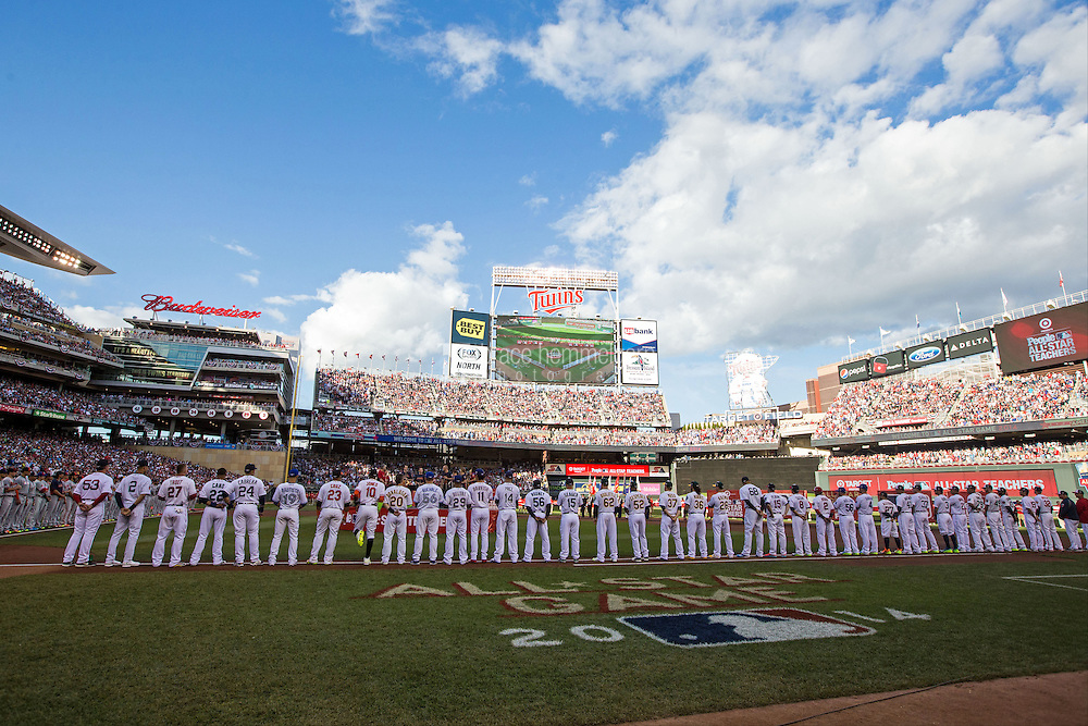 MINNEAPOLIS, MN- JULY 15: The American League All-Stars stand during the national anthem during the 85th MLB All-Star Game at Target Field on July 15, 2014 in Minneapolis, Minnesota. (Photo by Brace Hemmelgarn) *** Local Caption ***