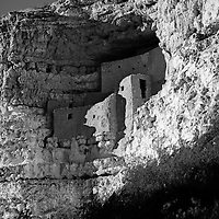 About 800 years ago, the Sinagua people carved their community into a limestone cliff. Today their multistory dwellings remain and offer insight into their history and culture. Montezuma Castle National Monument is located near Camp Verde, Arizona. Photographed November 7, 2014 as an airplane streaks overhead. © 2014 Crystal Chatham