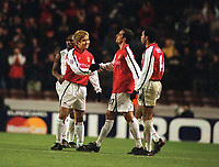 Fotball: Junichi Inamoto, Arsenal, celebrates with his team mates,Edu and Henry. Arsenal v Bayer Leverkusen. Champions League. 27.2.2002.<br />