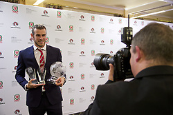 CARDIFF, WALES - Monday, October 5, 2015: Wales' Gareth Bale is photographed by Ian Cook with his Player of the Year, Fans' Favourite and Players' Player of the Year Awards after the FAW Awards Dinner at Cardiff City Hall. (Pic by David Rawcliffe/Propaganda)
