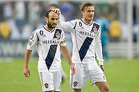 Los Angeles Galaxy midfielder David Beckham (23) and Los Angeles Galaxy forward Landon Donovan (10) during the 2012 Major League Soccer Championship match between the Houston Dynamo and the Los Angeles Galaxy at the Home Depot Center in Carson, California.  The Galaxy defeated the Dynamo 3-1 to capture their second straight MLS Cup title.