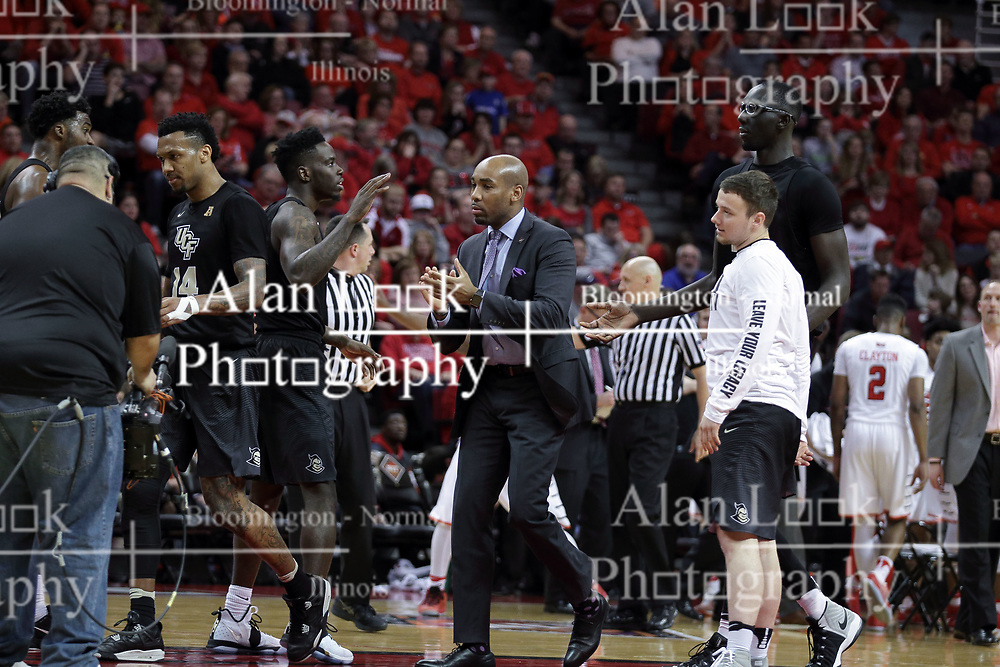 20 March 2017:  Knights celebrate during a College NIT (National Invitational Tournament) 2nd round mens basketball game between the UCF (University of Central Florida) Knights and Illinois State Redbirds in  Redbird Arena, Normal IL<br /> <br /> Asst. Coach Jamill Jones, photo center