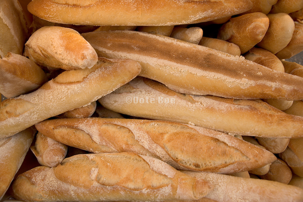 close up of fresh french bread in a basket