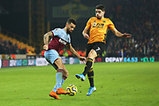 Ryan Fredericks cuts inside of Pedro Neto during the Premier League match between Wolverhampton Wanderers and West Ham United at Molineux, Wolverhampton, England on 4 December 2019.