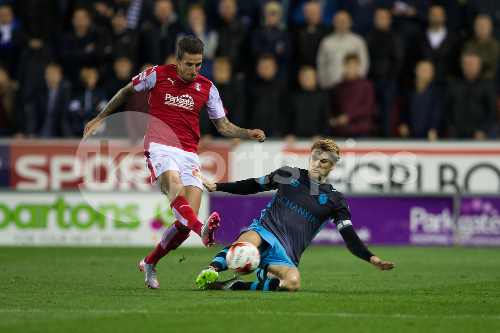 Glenn Loovens of Sheffield Wednesday tackles Matt Derbyshire of Rotherham United during the Sky Bet Championship match between Rotherham United and Sheffield Wednesday at the Aesseal New York Stadium, Rotherham, England on 23 October 2015. Photo by James Williamson.