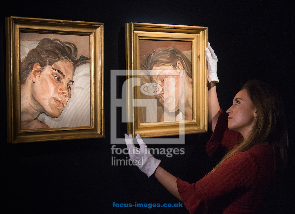 A gallery worker hangs Lucian Freud's Head of Ib, next to Head of Esther, a pair of Freud's portraits of his daughters, with each piece expected to fetch up to &pound;3.5 million at auction, in preparation for the 20th Century Art Sale Preview at Christie's, London<br /> Picture by Paul Davey/Focus Images Ltd +447966 016296<br /> 05/02/2016