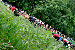 UK ENGLAND COOPERS HILL 31MAY04 - Contestands struggle up a steep 200-metre slpoe in pursuit of a 7-pound Cloucester Cheese which awaits the first runner to arrive at the top. The uphill races are an interlude between the more dangerous and spectacular downhill races. The cheese rolling is one of the oldest customs to have survived some saying, for hundreds of years, even pre-Roman times. The ceremony is reported to.have taken place originally at midsummer and to have been moved to Whitsun in early Saxon times. Some say it is a relic of an old heathen festival to celebrate the return of spring and.others say, when held in midsummer, it represented the waning of the sun as summer reached its height, but no one knows for sure....jre/Photo by Jiri Rezac..© Jiri Rezac 2004..Contact: +44 (0) 7050 110 417.Mobile:  +44 (0) 7801 337 683.Office:  +44 (0) 20 8968 9635..Email:   jiri@jirirezac.com.Web:     www.jirirezac.com