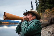 Mayo, Yukon Territory, Canada, September 2014. Jimmy Johnny, a 69 year old native tracker, is looking for his annual moose.  Band members of the First Nation of NaCho Nyak Dun return to their traditional fishing spot below the Fraser Falls on the Stewart River to fish for Whitefish and Chum . The nation has agreed to not fish salmon for the duration of a full life cycle of the declining species. So few salmon have reached their traditional spawning grounds that they are threatened by extiction.  Photo by Frits Meyst / MeystPhoto.com
