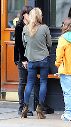 Kate Moss, daughter Lila Grace and husband Jamie Hince meet up with Kate's ex-partner Jefferson Hack and his girlfriend Anouck Lepere and Fran Cutler for sunday lunch at the Lemonia restaurant in Primrose Hill. Kate wearing a green shirt, black top, skinny jeans and suede boots took a short break from her lunch and met up with best friend Sadie Frost for a quick chat at a pub just up the road from the restaurant. When Kate and crew left the restaurant she kissed Jefferson goodbye while Jamie stood close by. London, UK. 29/09/2013<br />BYLINE MUST READ : GOTCHAIMAGES.COM<br /><br />Copyright by © Gotcha Images Ltd. All rights reserved.<br />Usage of this image is conditional upon the acceptance <br />of Gotcha Images Ltd, terms and conditions available at<br />www.gotchaimages.com
