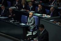 13 FEB 2014, BERLIN/GERMANY:<br /> Angela Merkel (M), CDU, Bundeskanzlerin, waehrend der Regierungserklaerung von Sigmar Gabriel (R), SPD, Bundeswirtschaftsminister, in einem Sonnenstrahl, Bundestagsdebatte zum Jahreswirtschaftsbericht, Plenum, Deutscher Bundestag<br /> IMAGE: 20140213-01-036