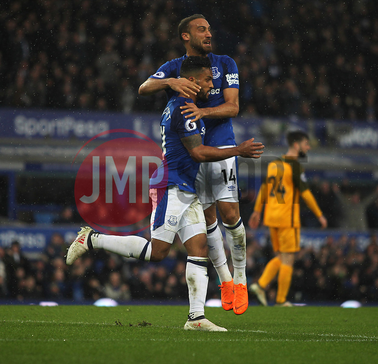 Theo Walcott (L) and Cenk Tosun of Everton celebrate after Gaetan Bong of Brighton and Hove Albion (Not Pictured) scored an own goal for their first - Mandatory by-line: Jack Phillips/JMP - 10/03/2018 - FOOTBALL - Goodison Park - Liverpool, England - Everton v Brighton and Hove Albion - English Premier League