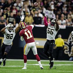 Oct 8, 2018; New Orleans, LA, USA New Orleans Saints defensive end Marcus Davenport (92) and linebacker Demario Davis (56) pressure Washington Redskins quarterback Alex Smith (11) during the third quarter at the Mercedes-Benz Superdome. The Saints defeated the Redskins 43-19.