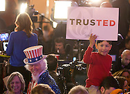 People listens to the polls as they wait for Republican presidential candidate Ted Cruz to speak to supporters at his election night party after Super Tuesday in Stafford, Texas, USA, 01 March 2016. Twelve states voted in the early primary on Super Tuesday across the country.