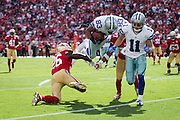 Dallas Cowboys wide receiver Terrance Williams (83) goes airborne after a tackle by the San Francisco 49ers at Levis Stadium in Santa Clara, Calif., on October 2, 2016. (Stan Olszewski/Special to S.F. Examiner)
