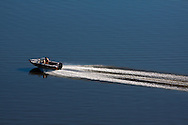 Small Boat Speeding Down the Mississippi River From Above