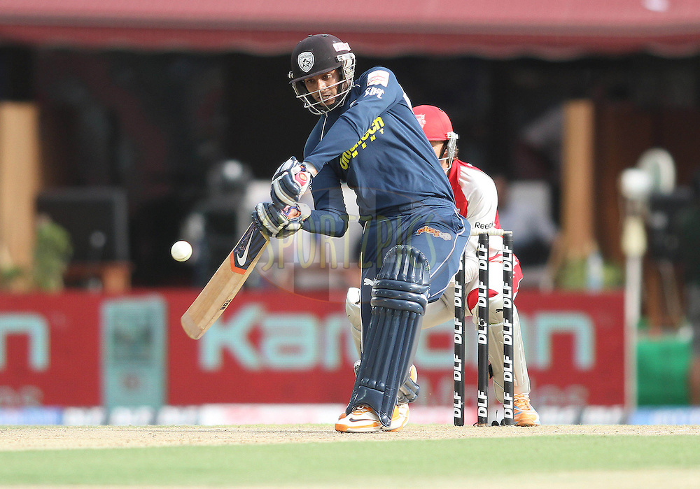 Dwaraka Ravi Teja of the Deccan Chargers looks to attack a delivery during match 67 of the Indian Premier League ( IPL ) Season 4 between the Kings XI Punjab and the Deccan Chargers held at the The HPCA Stadium in Dharamsala, Himachal Pradesh, India on the 21st May 2011..Photo by Shaun Roy/BCCI/SPORTZPICS