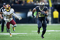 NEW ORLEANS, LA - NOVEMBER 19:  Mark Ingram II #22 of the New Orleans Saints runs the ball away from D.J. Swearinger #36 of the Washington Redskins at Mercedes-Benz Superdome on November 19, 2017 in New Orleans, Louisiana.  Saints defeated the Redskins 34-31.  (Photo by Wesley Hitt/Getty Images) *** Local Caption *** Mark Ingram II; D.J. Swearinger