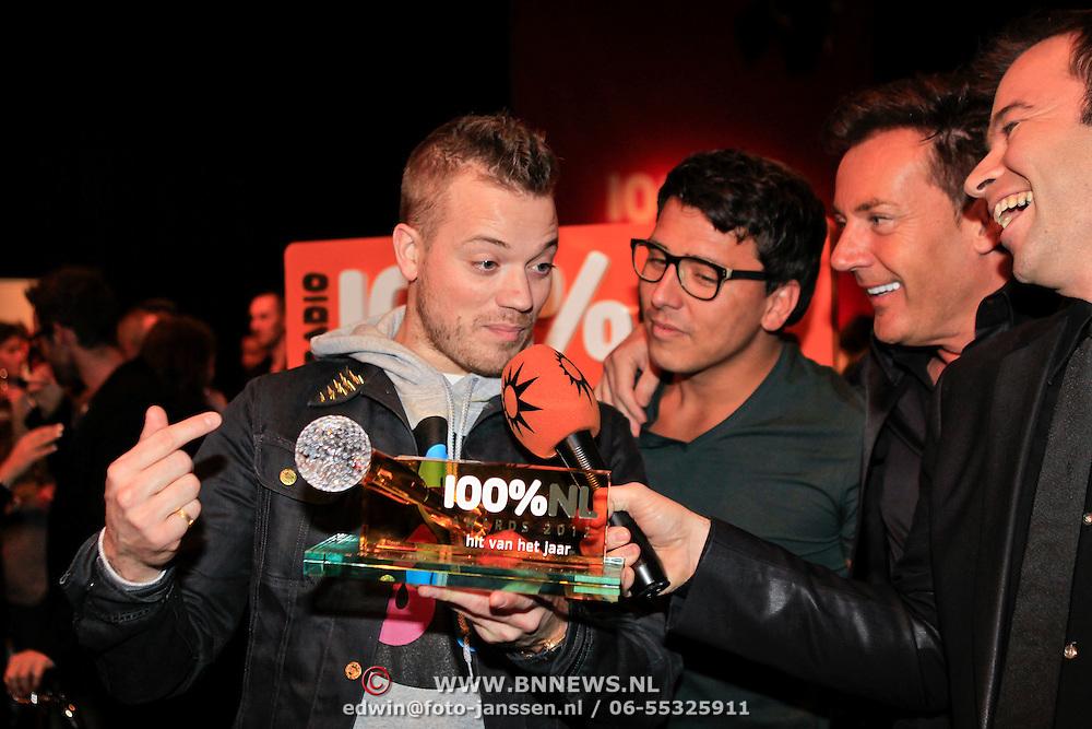NLD/Hilversum/20130109 - Uitreiking 100% NL Awards 2012, Gers Pardoel met zin award , Jan Smit, Gerard Joling, Peter van der Vorst