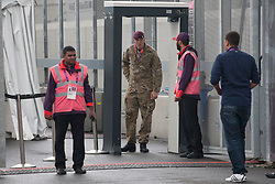 © licensed to London News Pictures. London, UK 20/07/2012. G4S security staff and a soldier guarding an entrance of the Olympic site on 20/07/12. Photo credit: Tolga Akmen/LNP