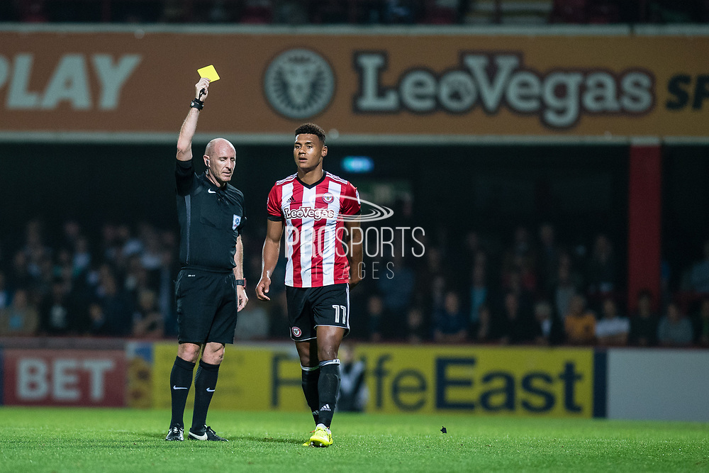 yellow card for Brentford (11) Ollie Watkins  during the EFL Sky Bet Championship match between Brentford and Derby County at Griffin Park, London, England on 26 September 2017. Photo by Sebastian Frej.
