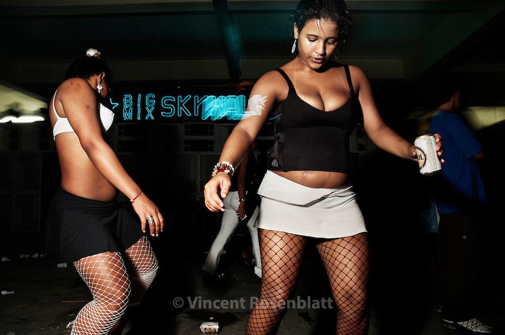Funkeiras at the Big Mix soundsystem's baile, club Emoções, favela Rocinha, Rio de Janeiro.