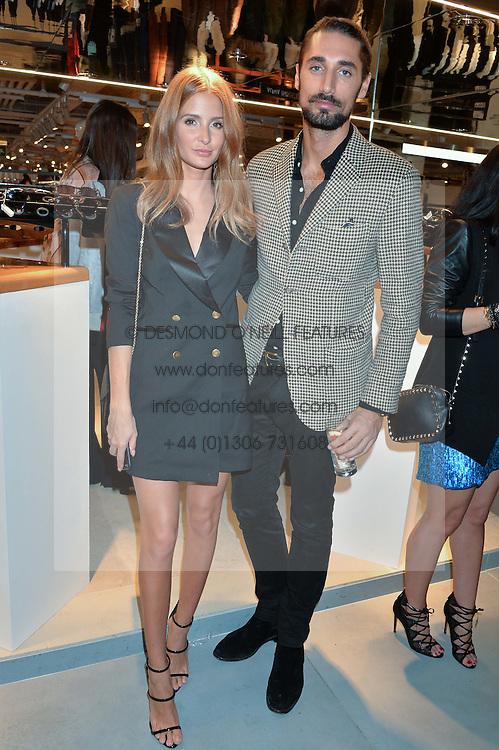 LONDON, ENGLAND 8 DECEMBER 2016: Millie Mackintosh, Hugo Taylor at a party to celebrate the collaboration of Taylor Morris Eyewear and The Morgan Motor Company held at Harvey Nichols, Knightsbridge, London, England. 8 December 2016.