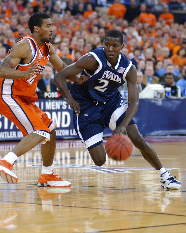 Nevada's Mo Charlo drives around Illinois' Luther Head during the first half of Illinois' 71-59 win over Nevada in the second round of the NCAA Tournament in Indianapolis, Ind., Saturday, March 19, 2005.&amp;#xA;&amp;#xA;Photo by David Calvert<br />