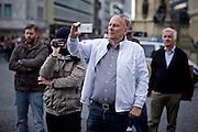 Frankfurt am Main   11 Apr 2015<br /> <br /> Am Samstag (11.04.2015) demonstrierten etwa 35 Personen der Gruppe &quot;Freie B&uuml;rger f&uuml;r Deutschland&quot; (FBfD, ex PEGIDA) auf dem Rossmarkt in Frankfurt am Main gegen &quot;Islamisierung&quot;, ihre Redebeitr&auml;ge gingen in dem Geschrei der etwa 800 Gegendemonstranten unter.<br /> Hier: Michael Mund, Stadtverordneter Frankfurt am Main, filmt mit einem Smartphone.<br /> <br /> &copy;peter-juelich.com<br /> <br /> [Foto honorarpflichtig   No Model Release   No Property Release]