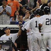 New York Yankees manager Joe Girardi (left), congratulates Brett Gardner, after his second inning grand slam home during the New York Yankees V New York Mets, Subway Series game at Yankee Stadium, The Bronx, New York. 12th May 2014. Photo Tim Clayton