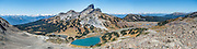 The volcanic pinnacle of Black Tusk (2319 m or 7608 ft) rises above Mimulus Lake, turquoise Black Tusk Lake, and Helm Lake (left to right), seen from Panorama Ridge Trail. The Black Tusk is a remnant of an extinct andesitic stratovolcano which formed 1.3-1.1 million years ago: after long glacial erosion, renewed volcanism 170,000 years ago made the lava flow and dome forming the tooth-shaped summit. The top of Panorama Ridge is 17 miles round trip with 5100 feet gain from Rubble Creek parking lot (or 6 miles/10k RT with 2066 ft/630m gain from either Taylor Meadows or Garibaldi Lake Backcountry Campground). A hiking loop to Garibaldi Lake via Taylor Meadows Campground is 11 miles (18k) round trip, with 3010 ft (850m) gain. Garibaldi Provincial Park is east of the Sea to Sky Highway (Route 99) between Squamish and Whistler in the Coast Range, British Columbia, Canada. This panorama was stitched from 5 overlapping images.