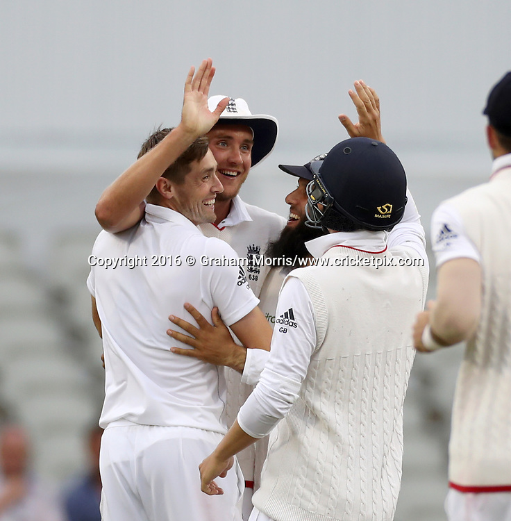 Bowler Chris Woakes (left) celebrates the win after Mohammad Amir is caught by Stuart Broad (centre) during the second Investec Test Match between England and Pakistan at Old Trafford, Manchester. Photo: Graham Morris/www.cricketpix.com 25/7/16