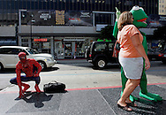 US-LOS ANGELES: A tourist posing with Kermit the Frog on Hollywood Boulevard, Spiderman is watching. PHOTO:  GERRIT DE HEUS