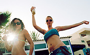 Two female clubbers enjoying themselves at Bora Bora Bar, Playa D'en Bossa, Ibiza, Spain, 2005