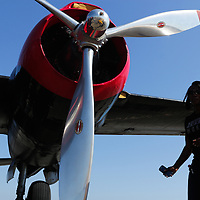 Latrice McKoy walks past the Spirit of North Carolina during Aviation Day Saturday October 11, 2014 at Wilmington International Airport in Wilmington, N.C. (Jason A. Frizzelle)