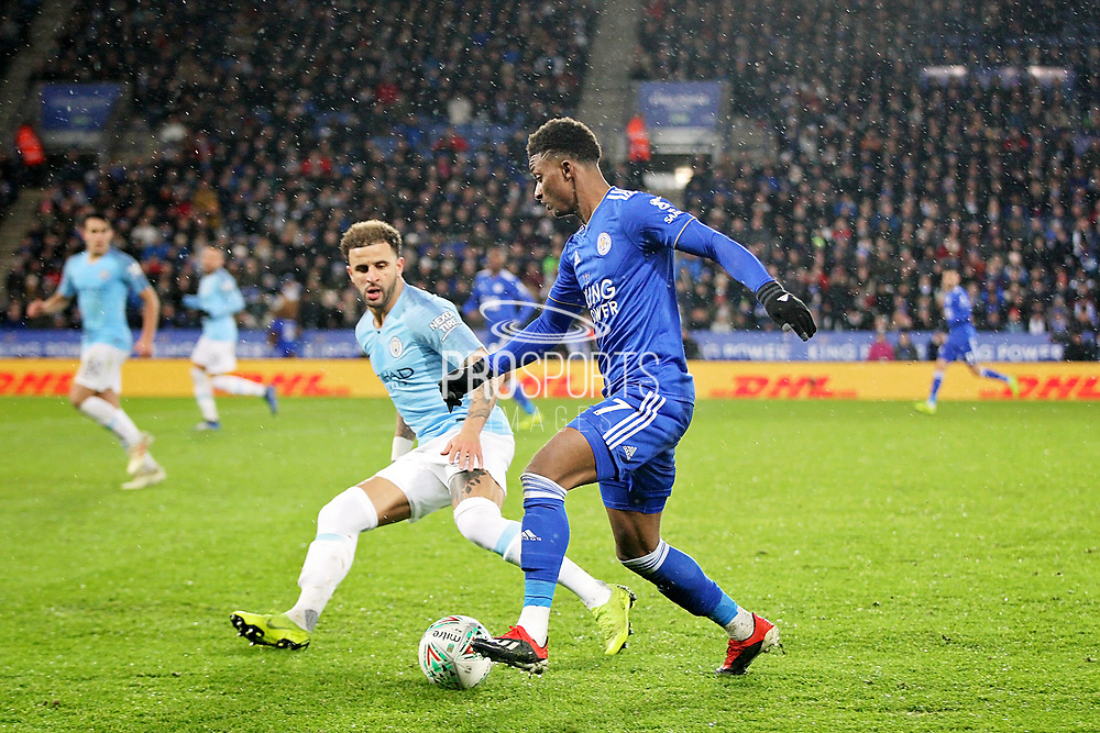 Leicester City midfielder Demarai Gray (7) takes on Manchester City defender Kyle Walker (2) during the quarter final of the EFL Cup match between Leicester City and Manchester City at the King Power Stadium, Leicester, England on 18 December 2018.