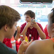 Joe Fluke,16, sits at a table with fellow members of the Smithsburg High School Marching Band inside the Dixie Diner, in downtown Smithsburg, Maryland, on Tuesday, September 26, 2017. Smithsburg is a very different town than the southern part of the district that includes Potomac and Germantown. Originally a District that was mostly rural, but included towns like Frederick and Hagerstown, Maryland's 6th District was redistricted in 2011, combining rural northern Maryland regions with more affluent communities like near Washington D.C. turning the district from Republican to Democrat. <br />  <br /> CREDIT: John Boal for The Wall Street Journal<br /> GERRYMANDER