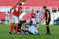 Coventry's John Fleck (on ground) is left dazed after collision with Swindon's Nathan Thompson and has to leave on a stretcher. NPower league one, Swindon Town v Coventry city at the County Ground in Swindon on Saturday 13th October 2012.  pic by  Andrew Orchard, Andrew Orchard sports photography,