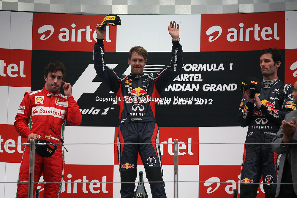 Sebastian VETTEL, Germany, D, Red Bull Racing Renault F1 Team  on the podium with Fernando ALONSO and Mark WEBBER  <br /> NOIDA, GP Formula 1 in INDIA near New Dehli, Formel 1 Grand Prix von INDIEN 28.10. 2012 - Rennen am BUDDH INTERNATIONAL Circuit F1  race  -  fee liable image - Photo Credit: &copy; ATP / THILL Arthur