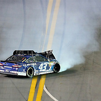 NASCAR Sprint Cup driver Aric Almirola (43) wrecks during the NASCAR Coke Zero 400 Sprint series auto race at the Daytona International Speedway on Saturday, July 6, 2013 in Daytona Beach, Florida.  (AP Photo/Alex Menendez)