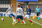 Connor Smith (C)(Heart of Midlothian) treads the ball through the Russian pair of Bogdan Logachev & Daniil Shamkin during the U17 European Championships match between Scotland and Russia at Simple Digital Arena, Paisley, Scotland on 23 March 2019.