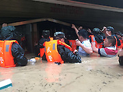 SONGTAO MIAO AUTONOMOUS COUNTY, CHINA - JULY 15: (CHINA OUT)<br /> <br /> Floods hit china<br /> <br /> Armed police officers help residents trapped in flood after a rainstorm on July 15, 2015 in Songtao Miao Autonomous County, Tongren City, Guizhou Province of China. A rainstorm hit Songtao Miao Autonomous County from Tuesday night to Wednesday morning with a 293.8-millimeter rainfall causing 1 person dead of lightning and affecting about 135,000 people. <br /> ©Exclusivepix Media