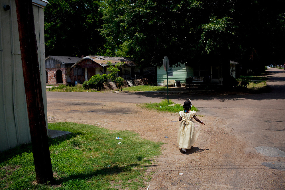 Dialia Wooten walks home from church in Baptist Town, Mississippi on Sunday, May 23, 2010. The youngest of three children, her father is currently in prison for running guns. Dialia's mother Vicki stresses the importance of an education to rise above their surroundings and the children all proudly bring home above average grades.