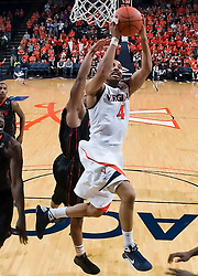 Virginia guard Calvin Baker (4) shoots a layup against Miami.  The Virginia Cavaliers fell to the Miami Hurricanes 62-55 at the John Paul Jones Arena on the Grounds of the University of Virginia in Charlottesville, VA on February 26, 2009.