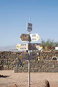 Israel, The Golan Heights, Abandoned military outpost on Mount Bental Now a war memorial site. Signpost directing to different cities