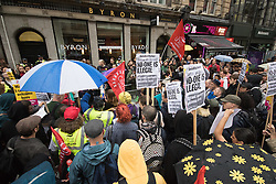 London, August 1st 2016. Protesters from Unite Hotel and Restaurant Workers Branch and other organisations demonstrate outside burger chain Byron's High Holborn outlet claiming that a recent training day was timed to coincide with a UK Border Agency raid, accusing the company of entrapment that has led to the deportation of 35 workers who it is alleged, using fake documentation had remained and were working in the UK illegally. PICTURED: