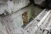 looking down in a partly burned out house