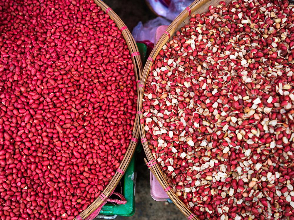 KYAING TONG, MYANMAR - CIRCA DECEMBER 2017: Baskets with peanuts at the Kyaing Tong market.