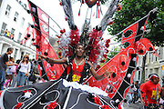 A performer dances his way through Ladbrook Grove, London during the Notting Hill Carnival 2007